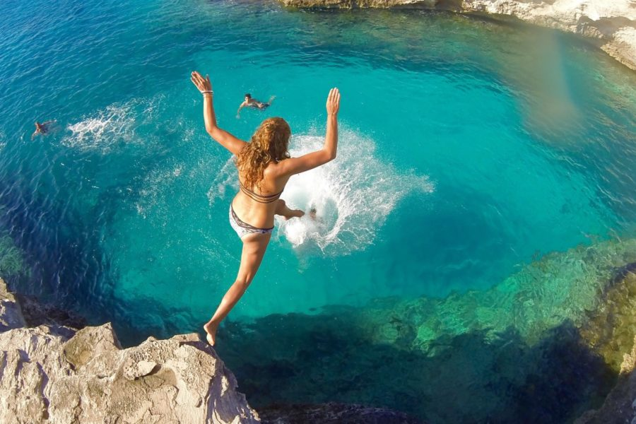 Auriol cliff jumping at Delvin's Cove West Caicos, Turks and Caicos