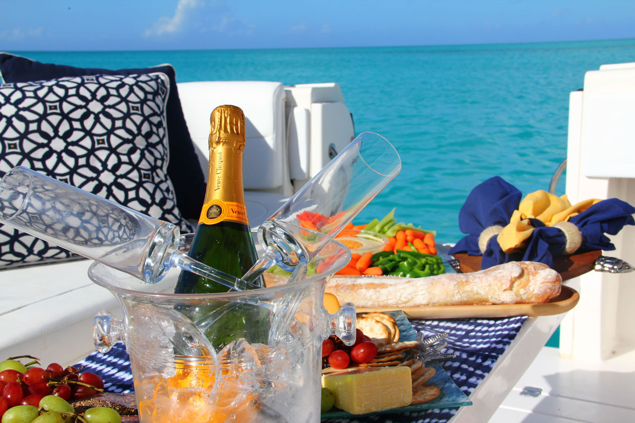 Champagne and gourmet lunch, available for custom cruises and luxury boat charters in Turks and Caicos.