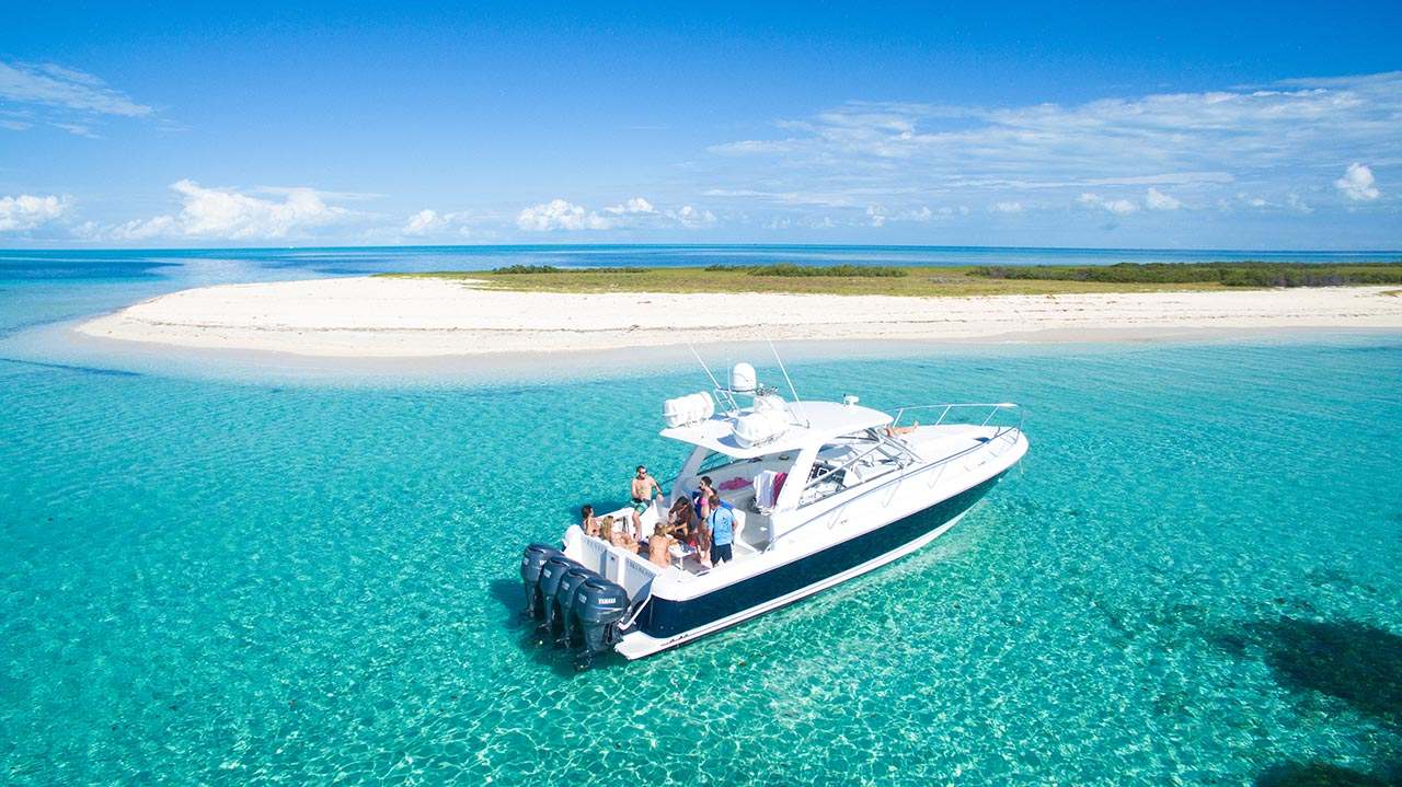 Serenity anchored off French Cay, Turks and Caicos while guests enjoy gourmet lunch on a custom cruise